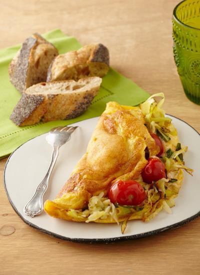Omelette de tomates confitados y puerro